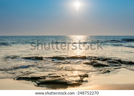 seascape. bright sun on the surface of the sea - stock photo