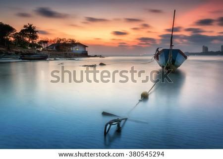 seascape, Fishing boats anchored along the beach at dusk. - stock photo