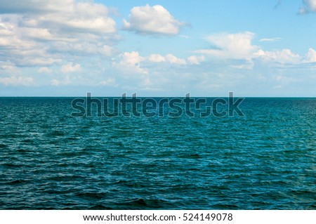 Seascape in Siam Gulf with blue sky and few clouds