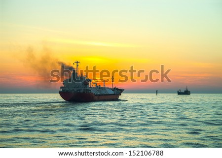 Seascape - LPG Tanker ship at sunrise. - stock photo