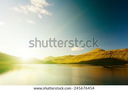 Seascape, mountains on the horizon. The Faroe Islands. The sunrise. - stock photo