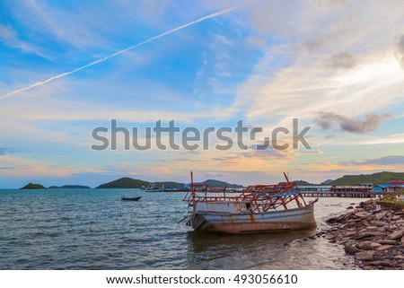 Seascape of sunset with dead long tail boat at Chonburi province, Thailand