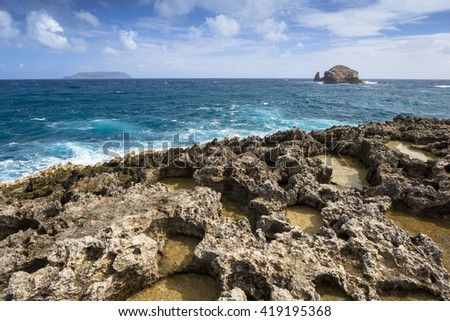 Seascape on a windy day at cape Pointe des Chateaux in Guadeloupe - stock photo