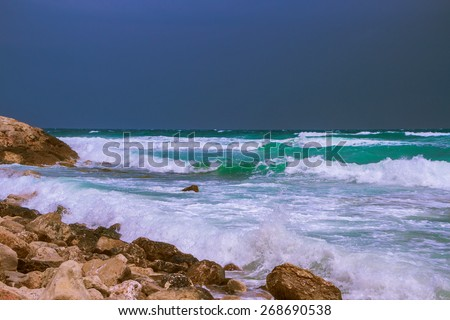 Seascape on the Mediterranean Sea before the storm in the rocky coast - stock photo