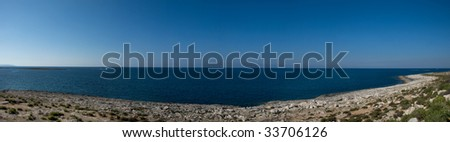 Seascape Panorama with typical garigue landscape found in Malta in the foreground - stock photo