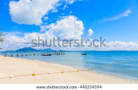 Seascape pier beach and blue sky with clouds Thailand - stock photo