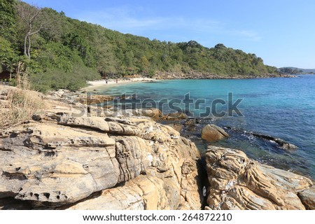 seascape rocky shore and blue water off the coast of Thailand on a sunny day - stock photo