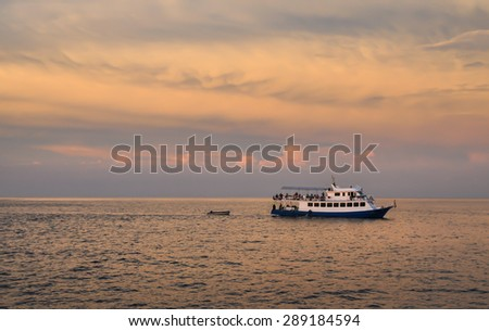 seascape scenic sunset and  boat  off the coast of Similan, Andaman ,Thailand  - stock photo