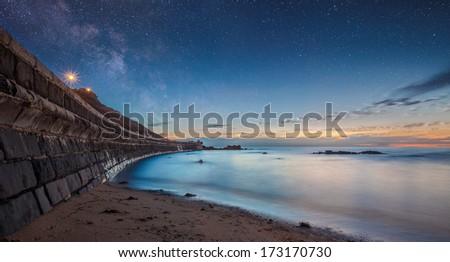 Seascape shot of sunset on the beach, Mornington Peninsula, Victoria, Australia - stock photo