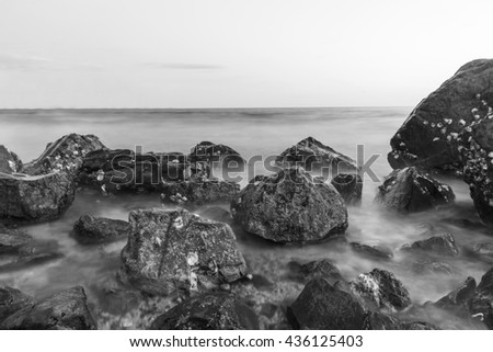 seascape,stone beach and sea wave.long exposure.black and white tone