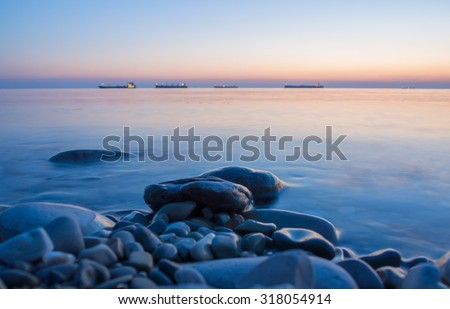 Seascape stones in water - stock photo