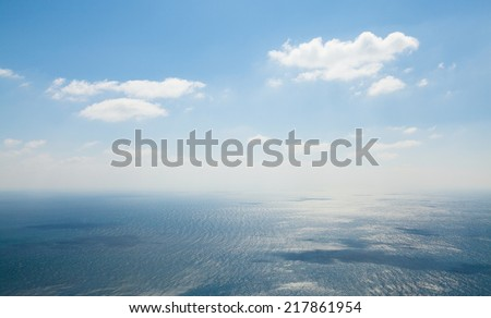 Seascape. Storm at sea with divorces from the wind and the shadows of the clouds. Photographed in the summer on a hot sunny day. - stock photo