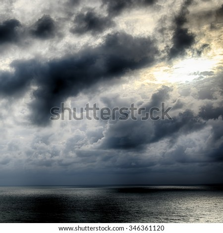 Seascape-Sunbeams shine through the clouds and reflected in the sea.HDR image