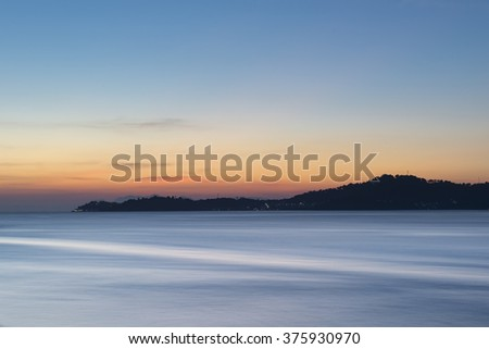 Seascape sunset and mountain view - stock photo