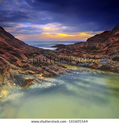 Seascape view stone and dramatic cloud  - stock photo