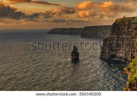 seascape with beach and large cliffs by the coast - stock photo