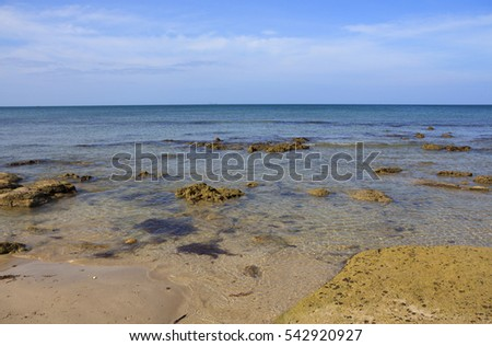 seascape with big textured stone on a foreground in transparent ocean water selective focus Koh Lanta Thailand
