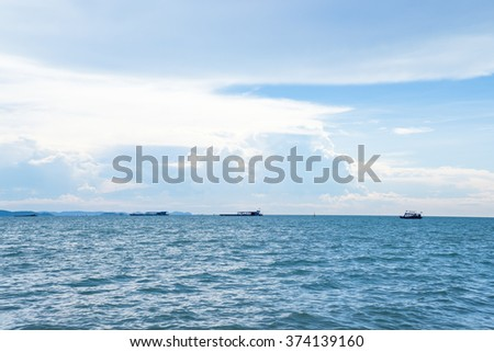 Seascape with blue sky and boats off the coast of Thailand. - stock photo
