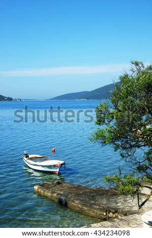 Seascape with boat from Kumbor (Montenegro) - stock photo