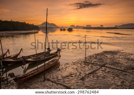 seascape with fishing village on sunrise in Thailand. - stock photo