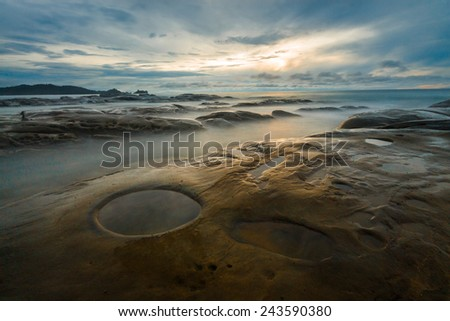 Seascape with long exposure on the rocks. - stock photo