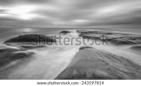seascape with long exposure on the rocks.  Black and white. - stock photo