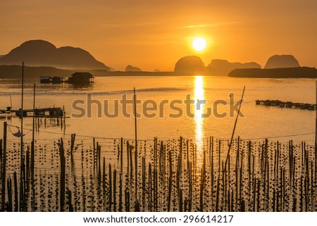 seascape with oyster farm at fishing village on sunrise in Thailand.