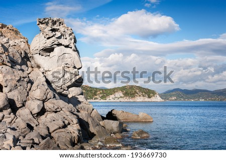 Seascape with rocks forming a big face - stock photo