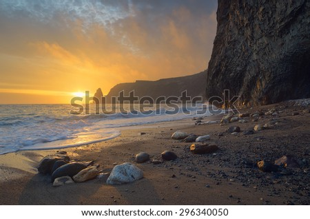 Seascape with sunset. Evening by the sea. Beautiful rock on the shore. Crimea - stock photo