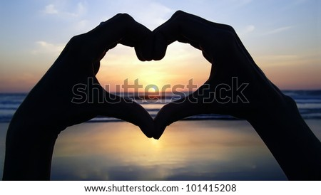 Seascape with symbol-heart in the foreground. - stock photo