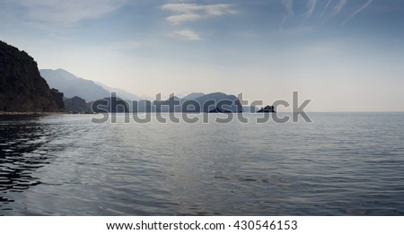 seascape with the water surface and the mountains of Montenegro