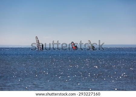 Seascape with windsurfer on swimming on sea surface. Beautiful Gdanska bay in summer - stock photo