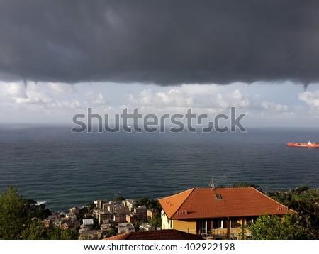seascpae in Genoa with twister - stock photo