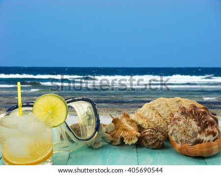 Seashells and beach cocktail. Beach cocktail. Beach party.  Beach drink. Tropical relax. - stock photo