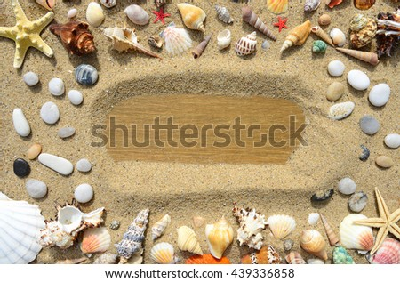 Seashells, sand and starfish on a old wooden background - stock photo