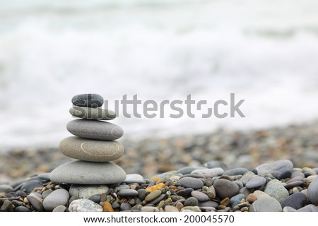 Seashore background with stone construction - stock photo