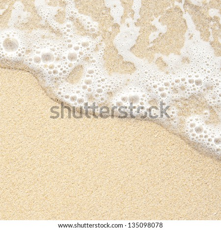 Seashore texture. line water foam over clean sand. - stock photo