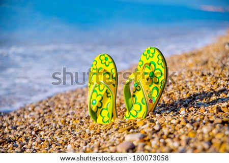 seashore. Things for the beach towel, sunscreen, flip flops - stock photo