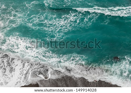 Seashore with rolling waves, view from a height of 300 meters - stock photo