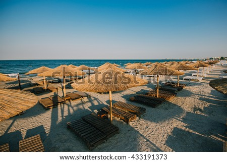 seaside, beach with sunbeds and umbrellas
