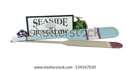 Seaside Bungalow Sign with Boat Oars and Glass Floats - path included - stock photo