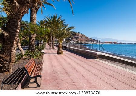Seaside promenade palm trees ocean view, San Sebastian, La Gomera island, Spain - stock photo