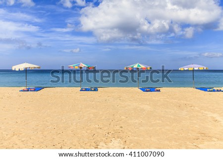 Seaside view with an umbrella, Summer vacation concept background - stock photo