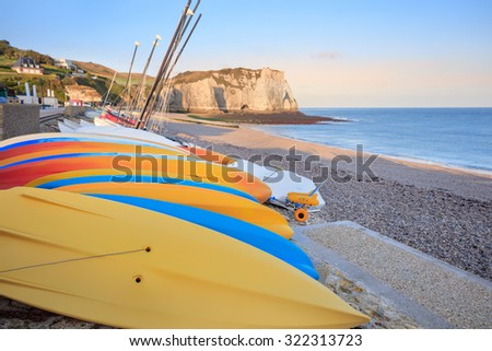 seaside village of Etretat with kayaks on the shore, Normandy, France