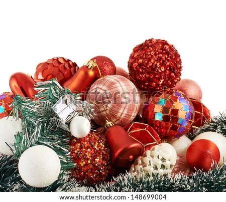 Seasonal Christmas decoration background as a pile of xmas tree decorations over white background - stock photo