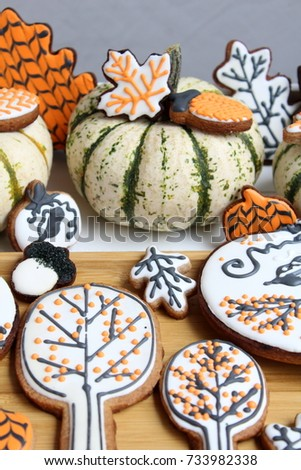 Seasonal decorated sugar honey cookies for autumn and thanksgiving celebration over wooden surface