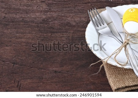 seasonal easter table with cutlery - stock photo