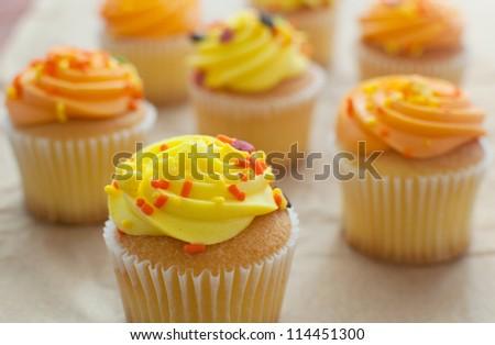 Seasonal fall orange and yellow cupcakes horizontal - stock photo