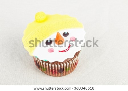 Seasonal festive Christmas mini dessert cupcakes in traditional decorative symbols elements.