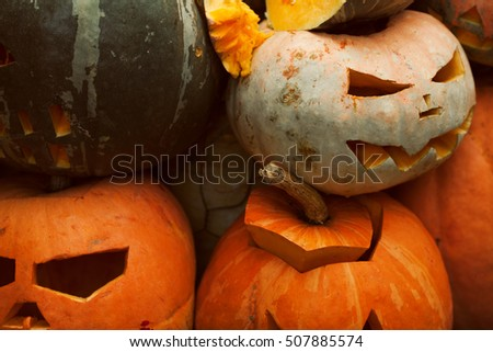 Seasonal holiday concept. Group of funny smiling Halloween pumpkin heads. Close up. Outdoor shot